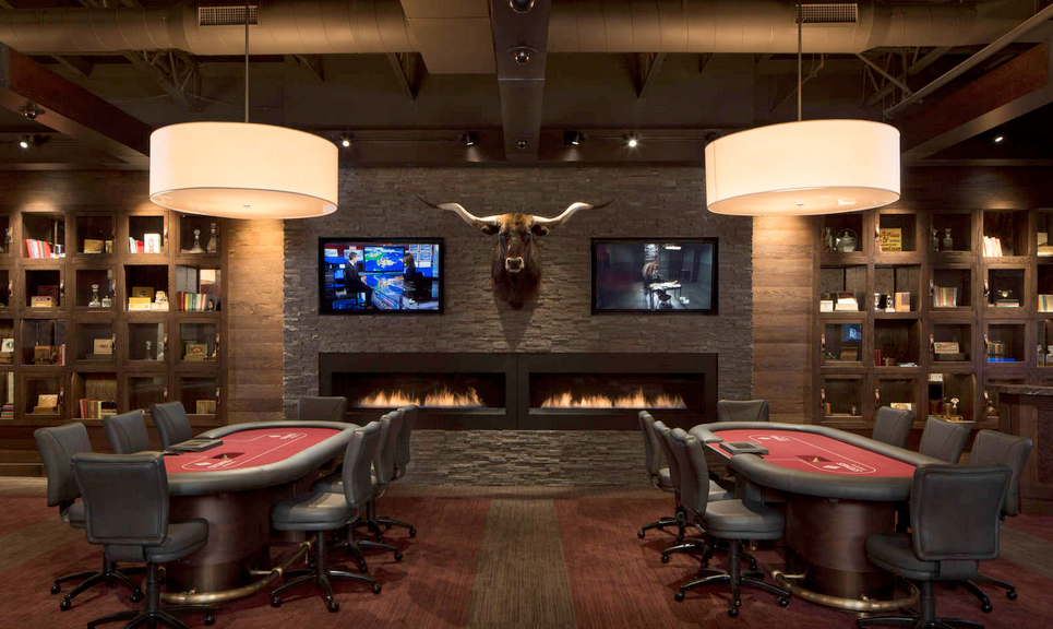 Flat Screen TVs installed on Stacked Stone Wall in a Casino