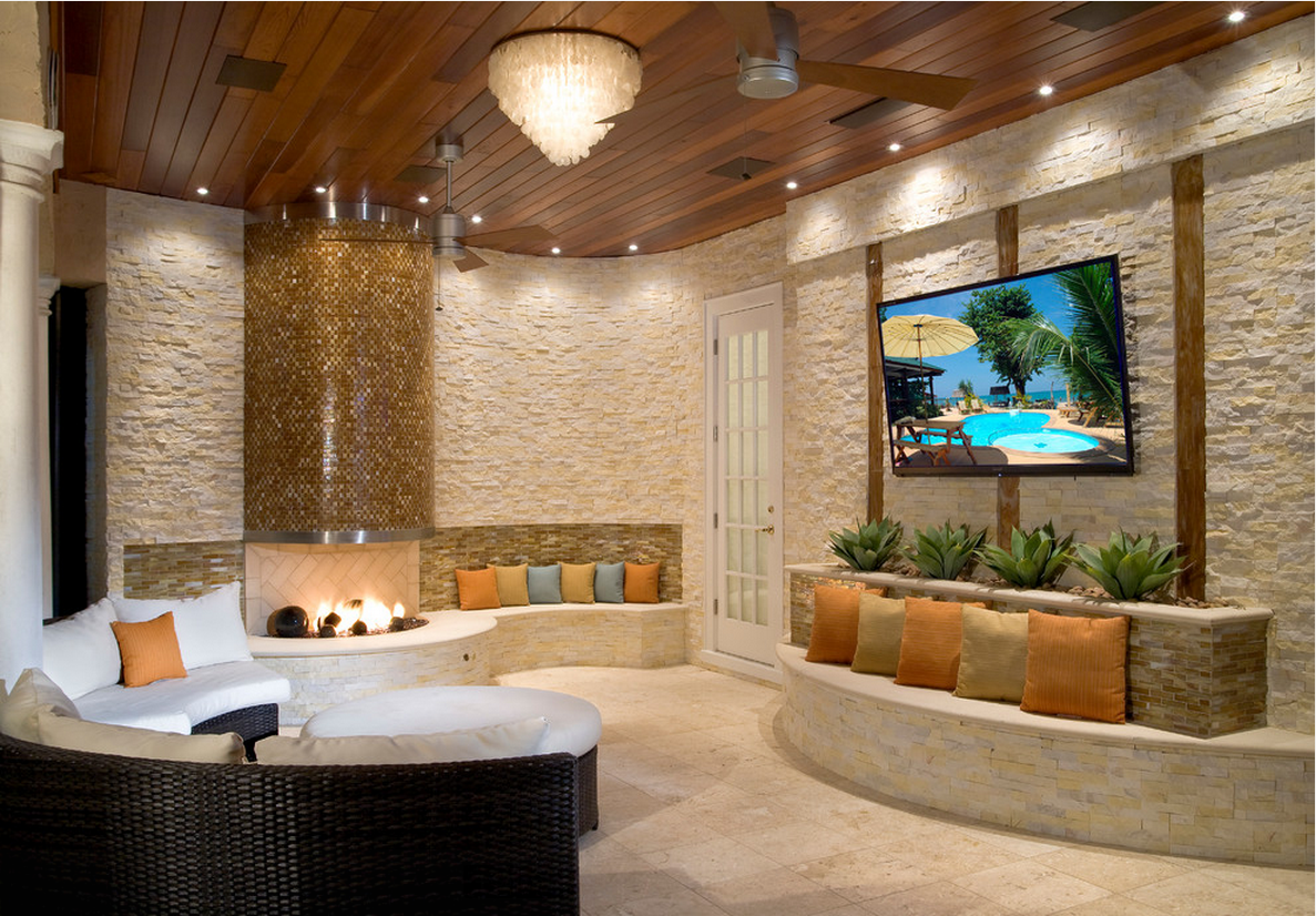 Residential Outdoor Living Space in Fort Myers, FL using Ivory Stacked Stone on a fireplace and curved walls