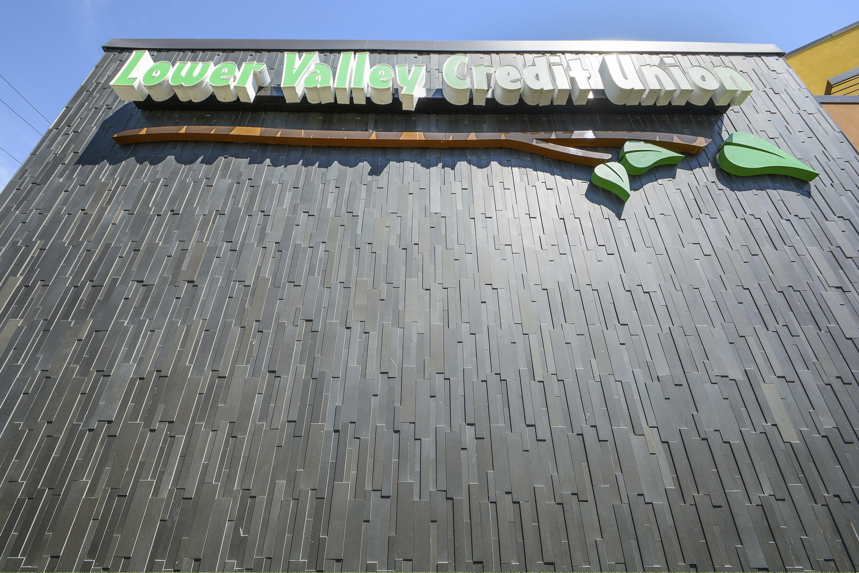 Signage at a bank in Washington state that used Norstone 3D Basalt panels in Ebony on a vertical orientation.