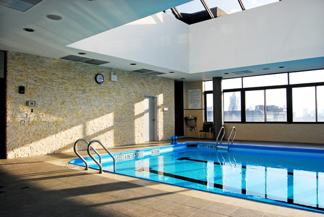 Ivory Ledgestone Feature Wall on Indoor Pool with New York City Skyline Views and a glass roof