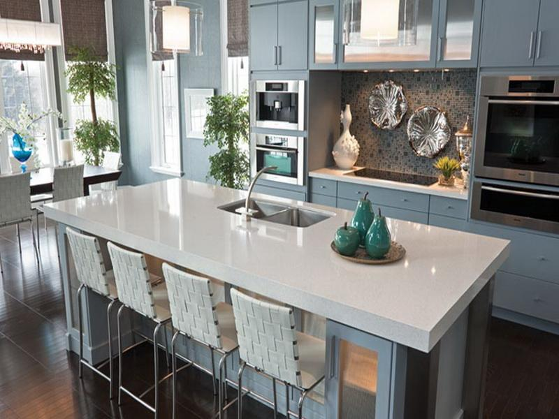 Designer Kitchen featuring an island with a white quartz kitchen countertop