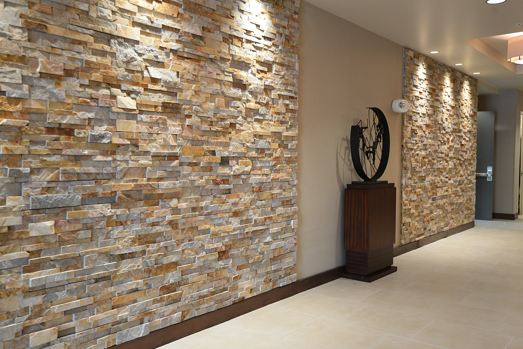 Aztec Stone Veneer Wall Panels used in feature walls of a lobby in Orlando