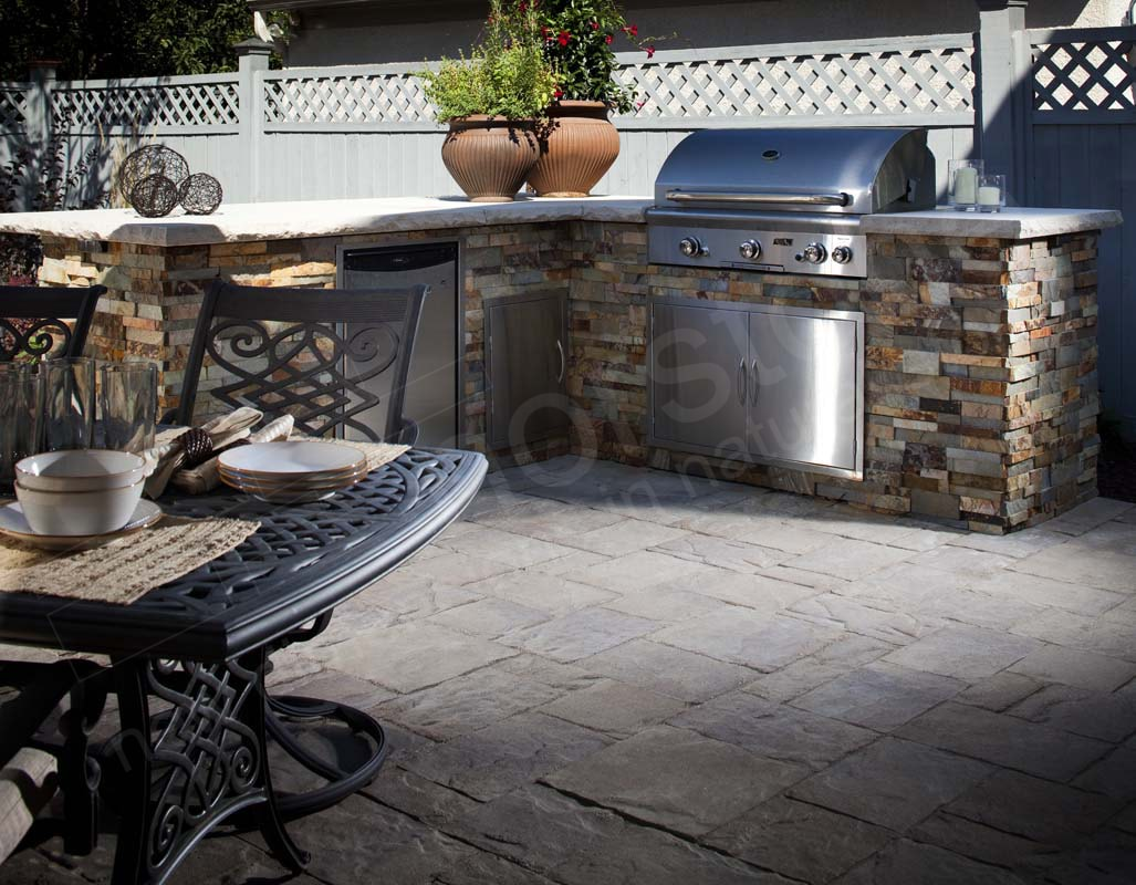 Norstone Ochre XL Stacked Stone Rock Panels on an outdoor kitchen with a stainless steel grill