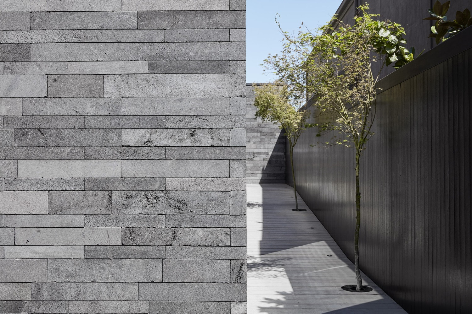 Norstone Planc in a custom platinum blend used on the exterior walls of an urban outdoor space.