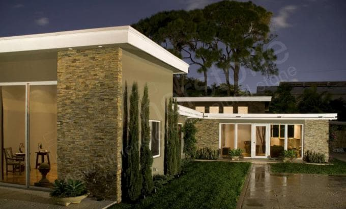 Norstone thin stone rock panels used as stone siding on the exterior of a mid century modern home in South Florida