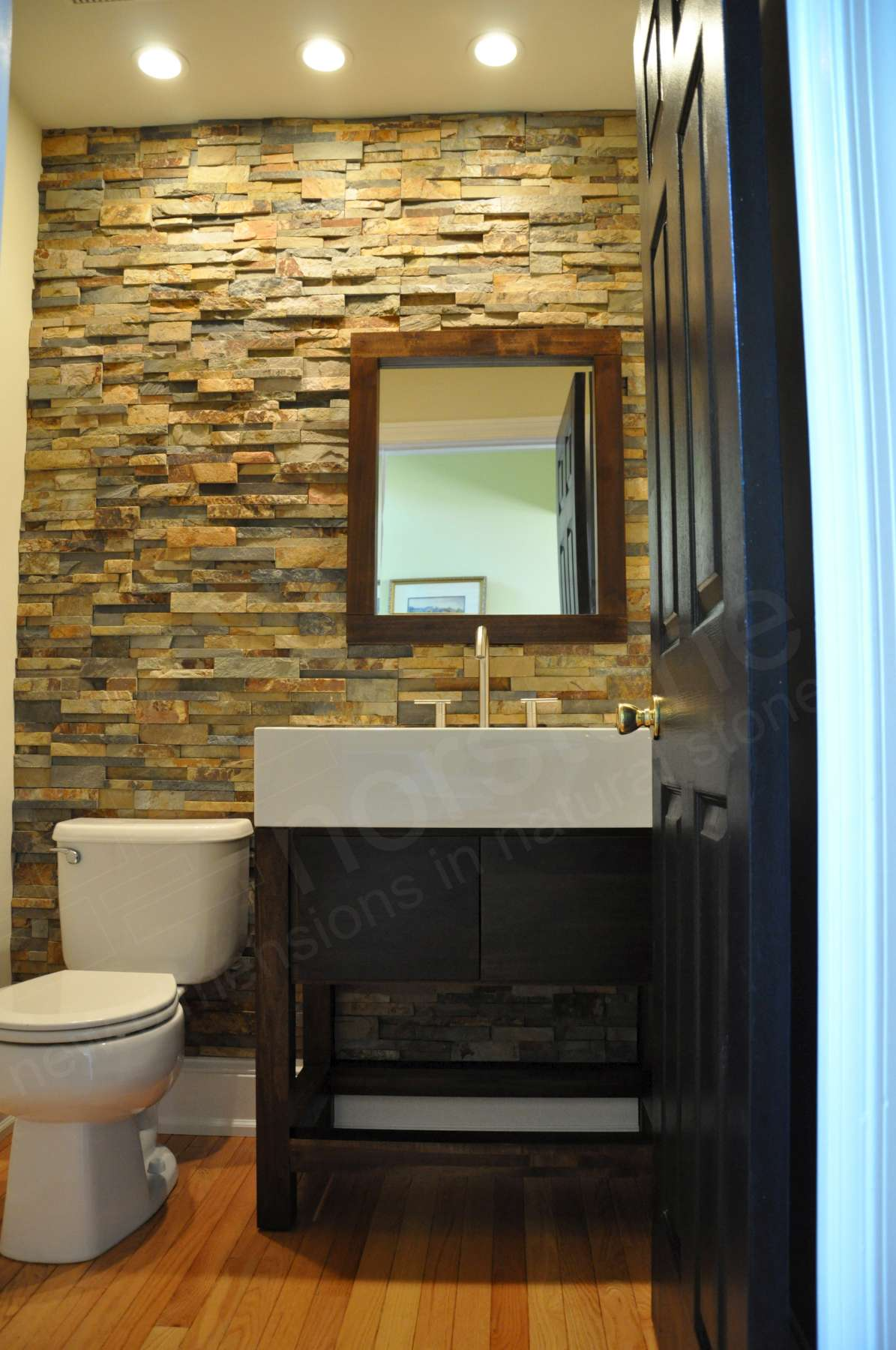 Small Powder Room with a stacked stone feature wall