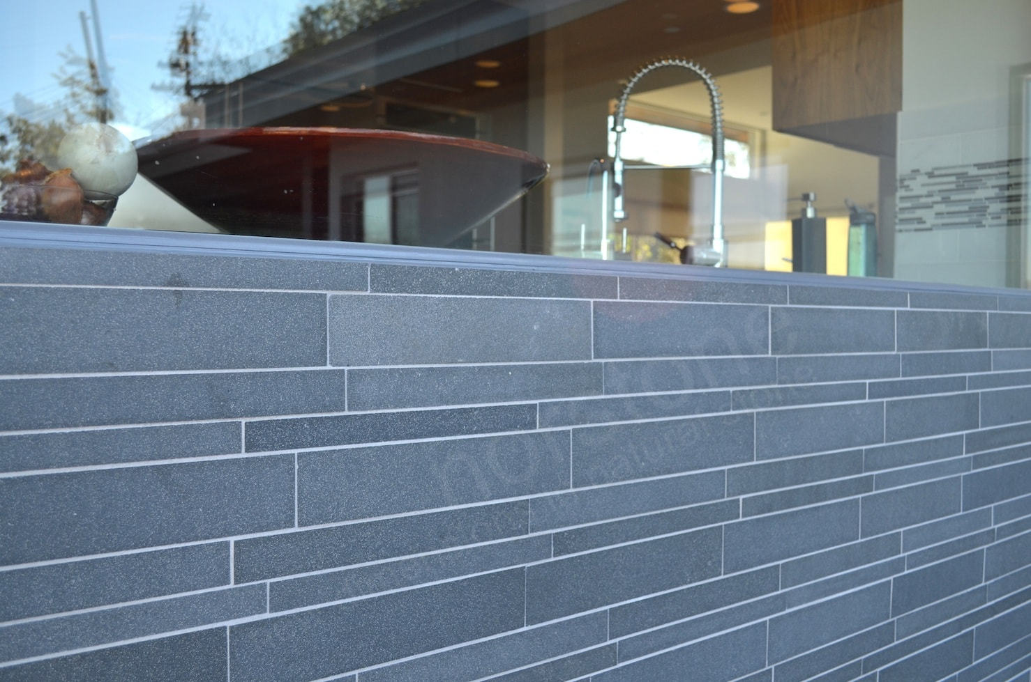 Norstone Grey Lynia Mosaic Wall Tile installed with a light color grout.