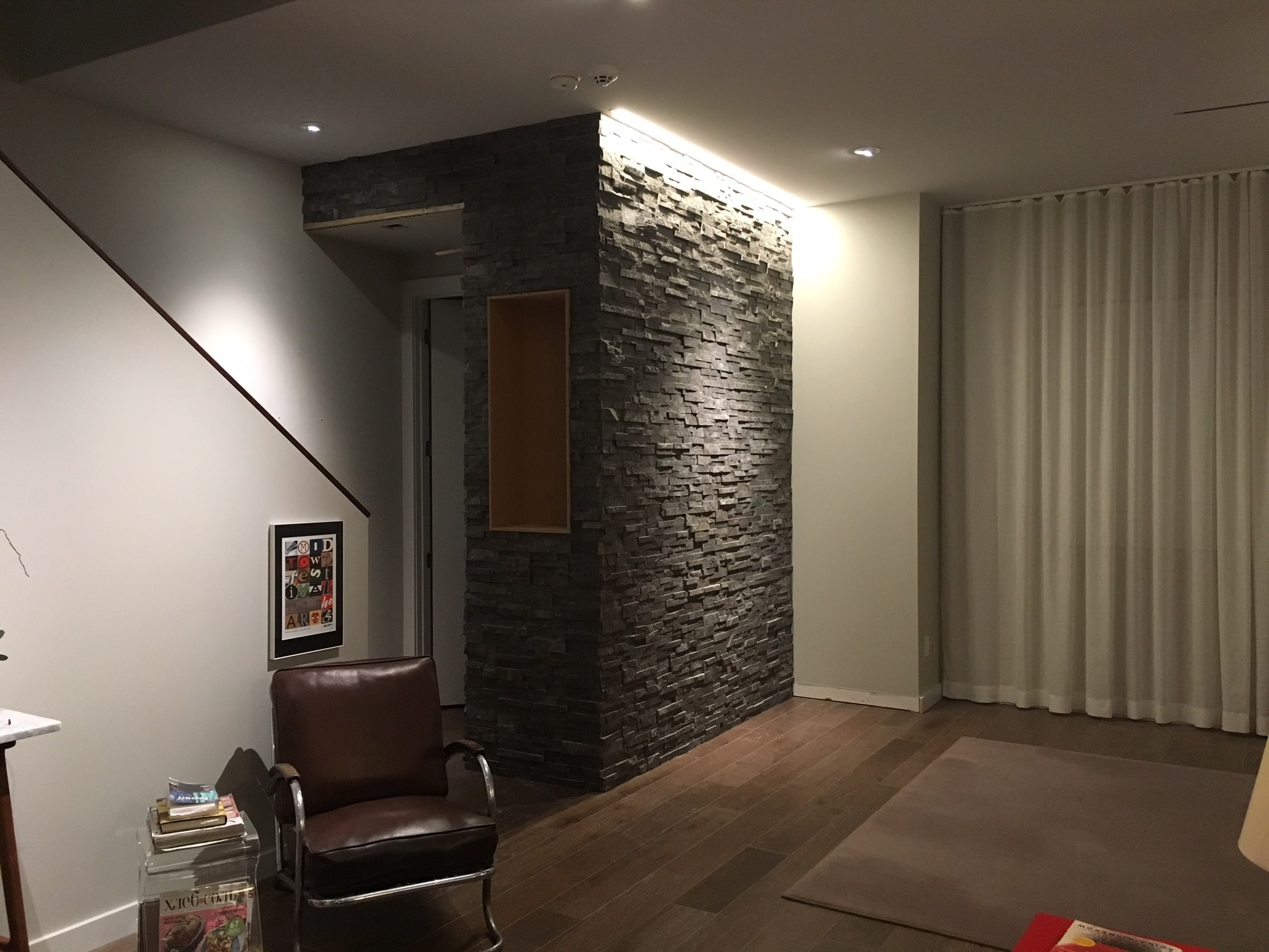 Stacked Stone Entryway Feature Wall project using Norstone Charcoal Standard Series Rock Panels