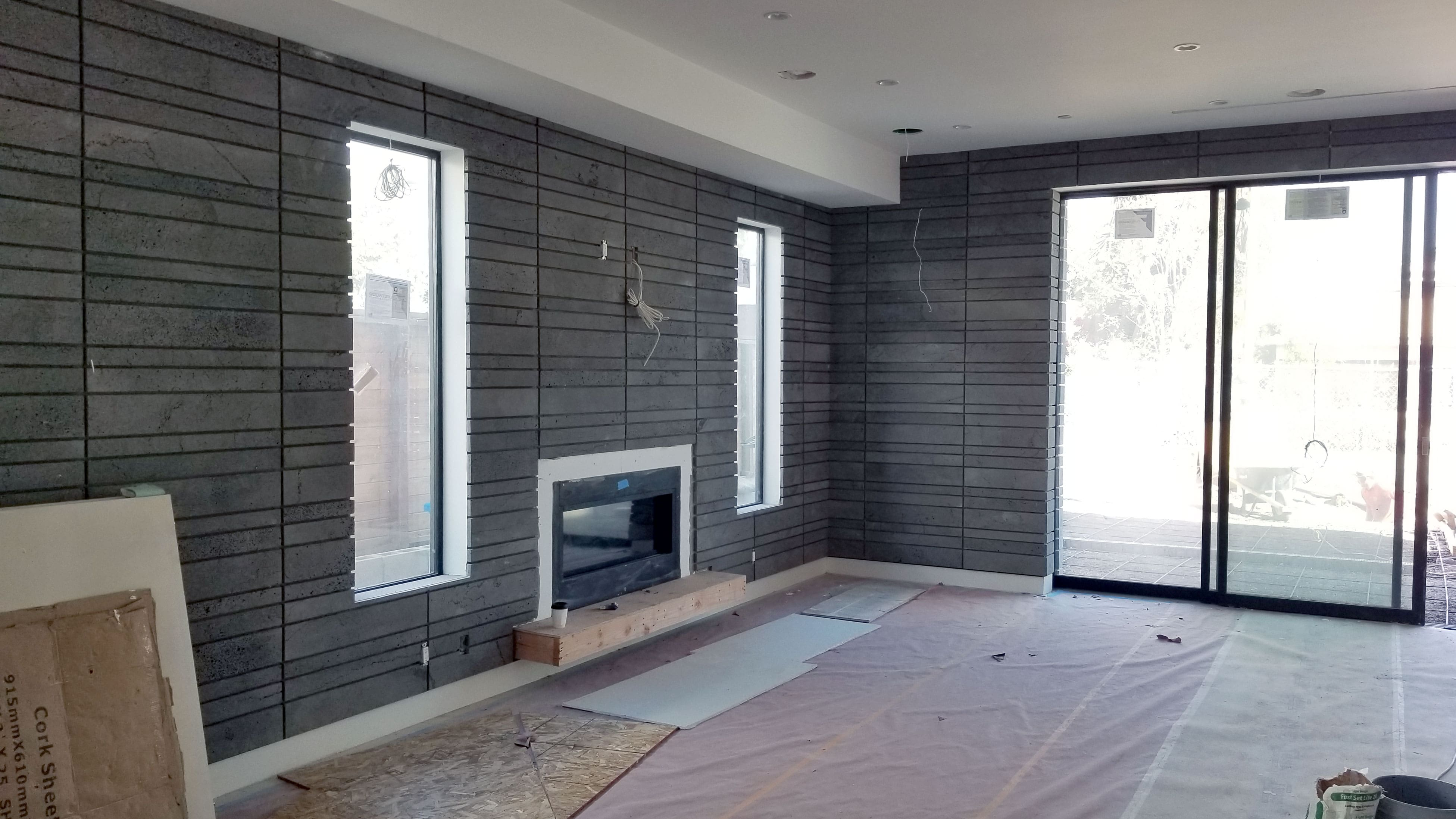 Norstone Planc Large Format Tile on interior feature wall with fireplace in Hollywood, CA