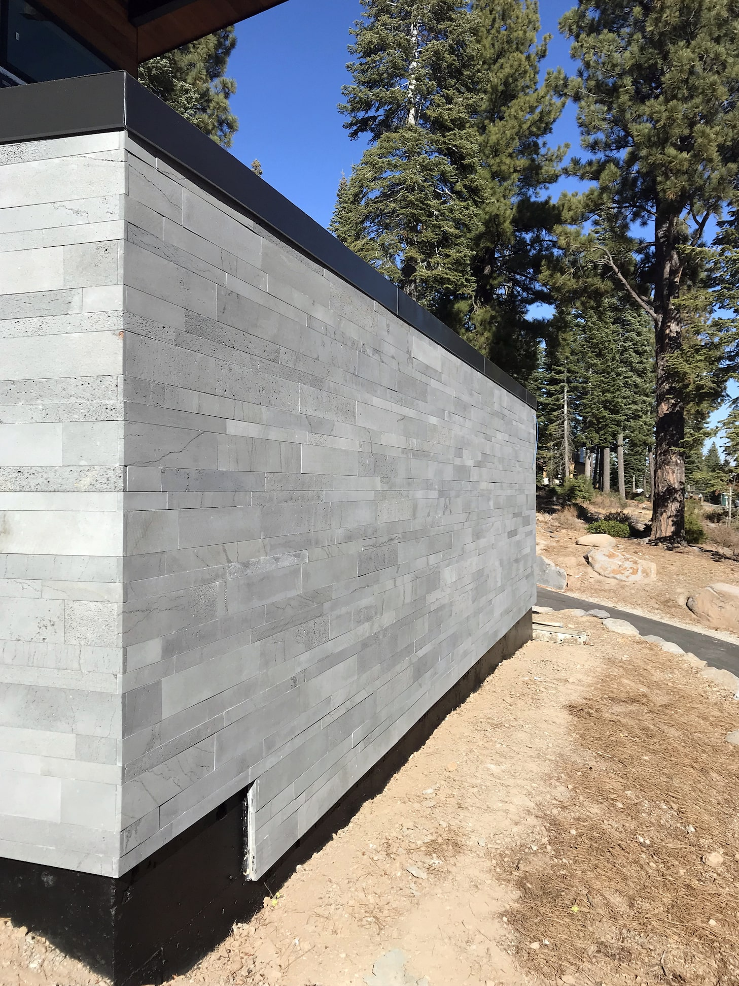 Norstone Platinum Planc Large Format Tile on an exterior feature wall in modern designed hillside home in Reno