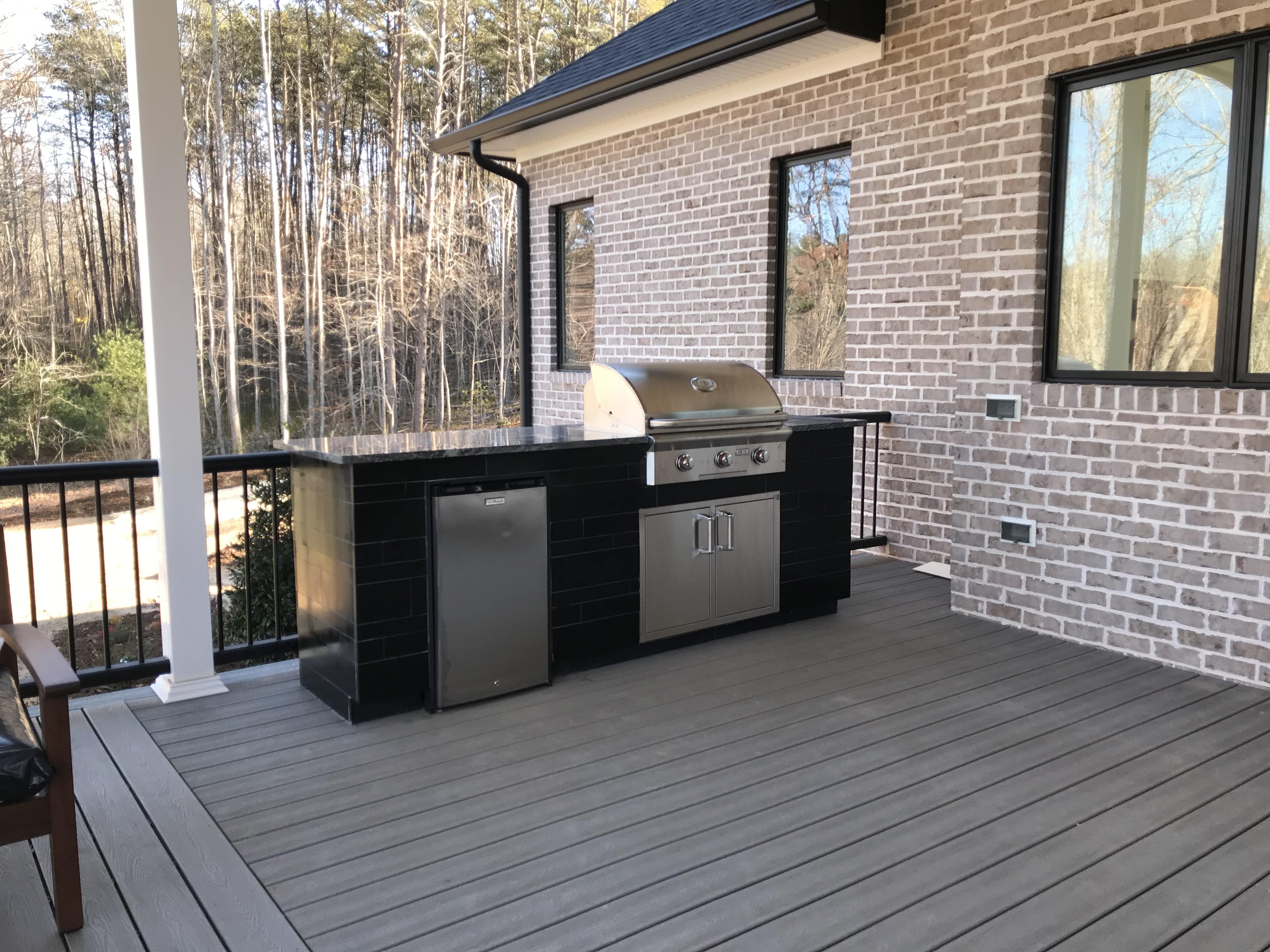 Ebony Planc Large Format Tile used to clad the exterior of a residential outdoor kitchen project