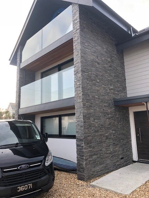 Norstone Charcoal Slimline Stone Veneer Panels installed on a multilevel feature wall on a residential project
