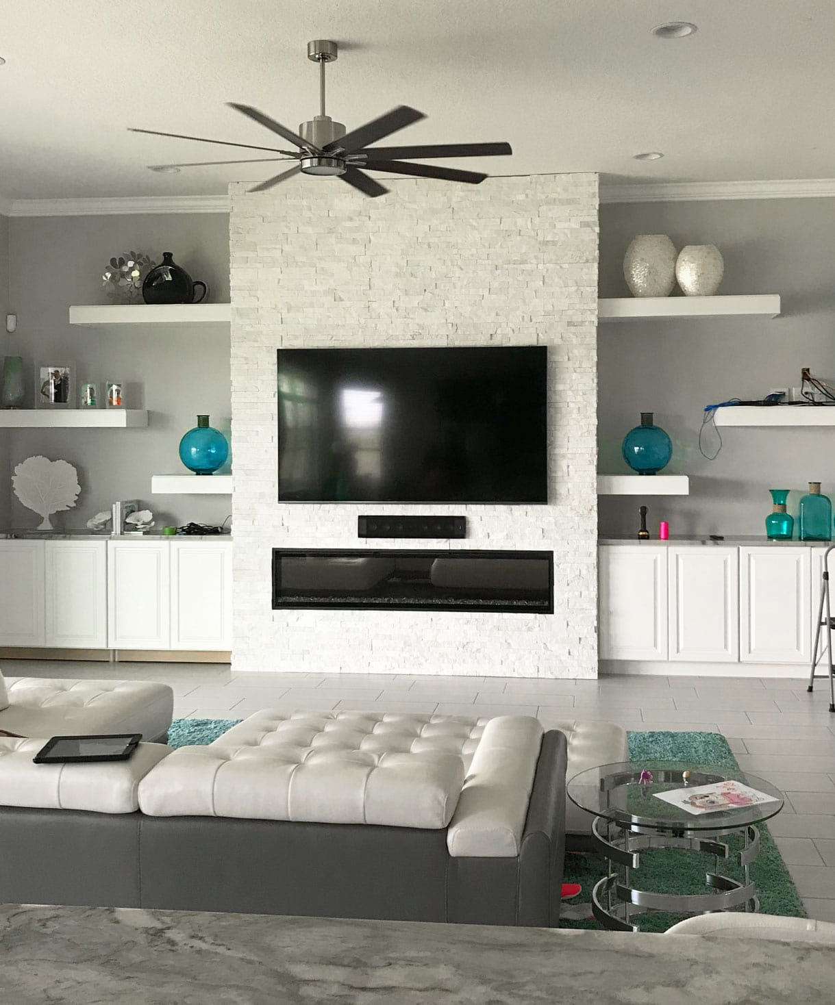 White Stacked Stone on a fireplace in a modern living room was a very popular trend in the summer of 2019