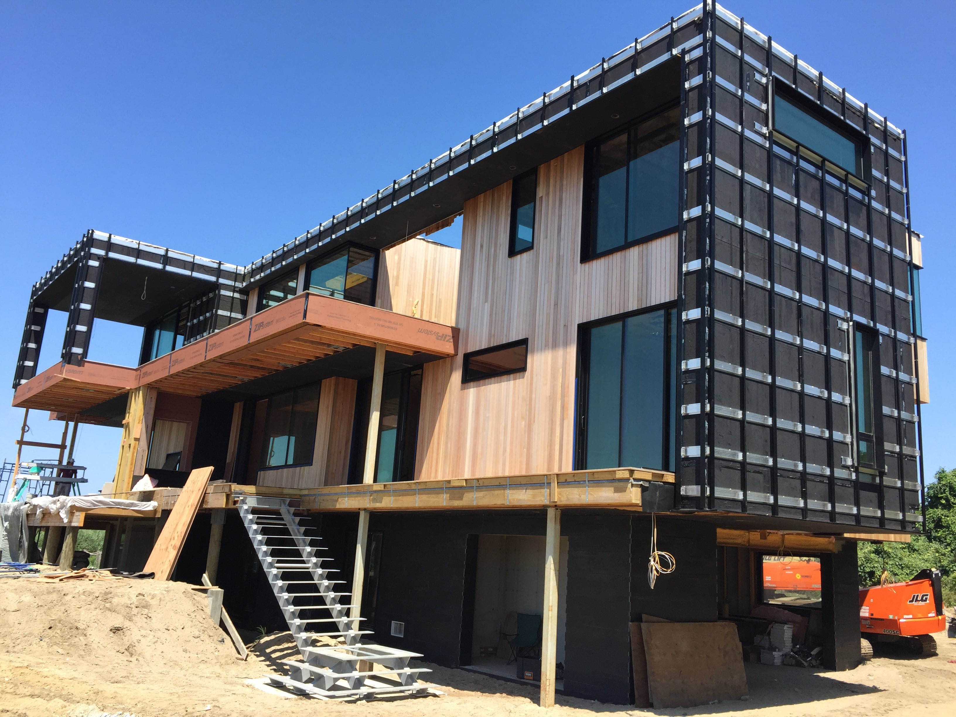Under Construction Home in the Hamptons using Ebony Planc on the lower lever exterior facade