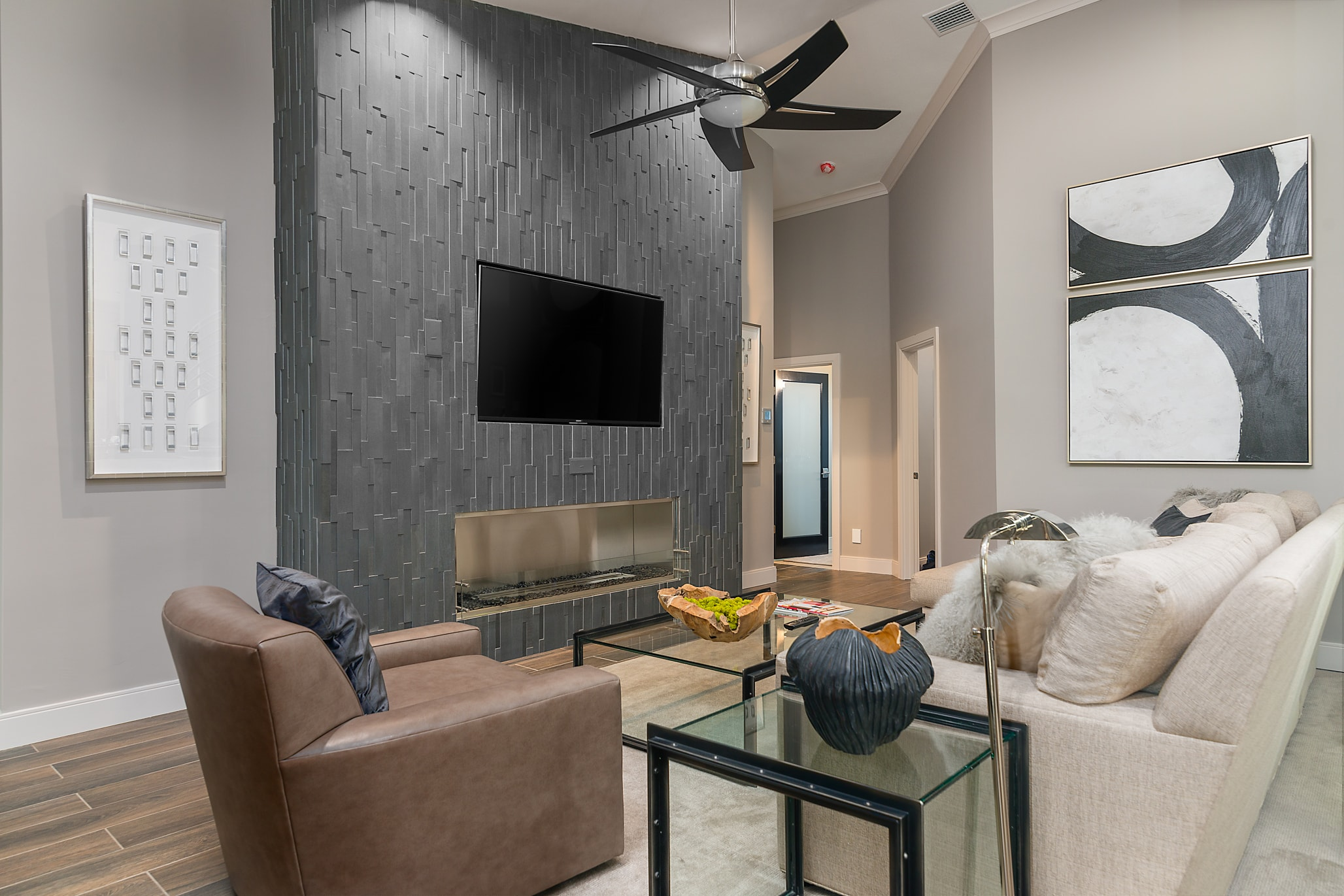 Project profile review of a fireplace project in Tampa, FL that used Norstone Basalt Grey Aksent 3D stone veneer panels on a modern styled fireplace