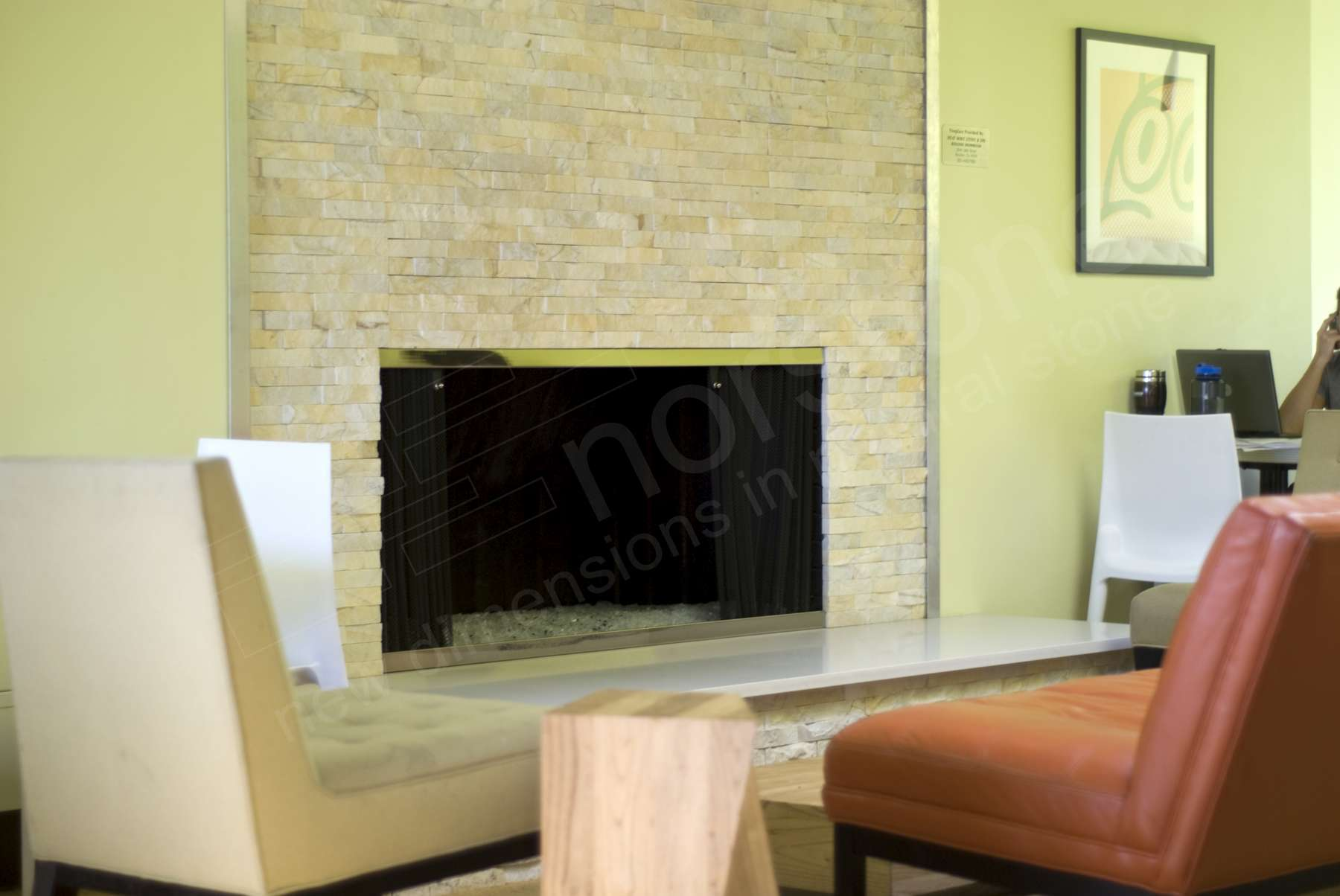 Norstone Ivory Stacked Stone Rock Panels featured on a fireplace application in a coffee shop in Denver, CO