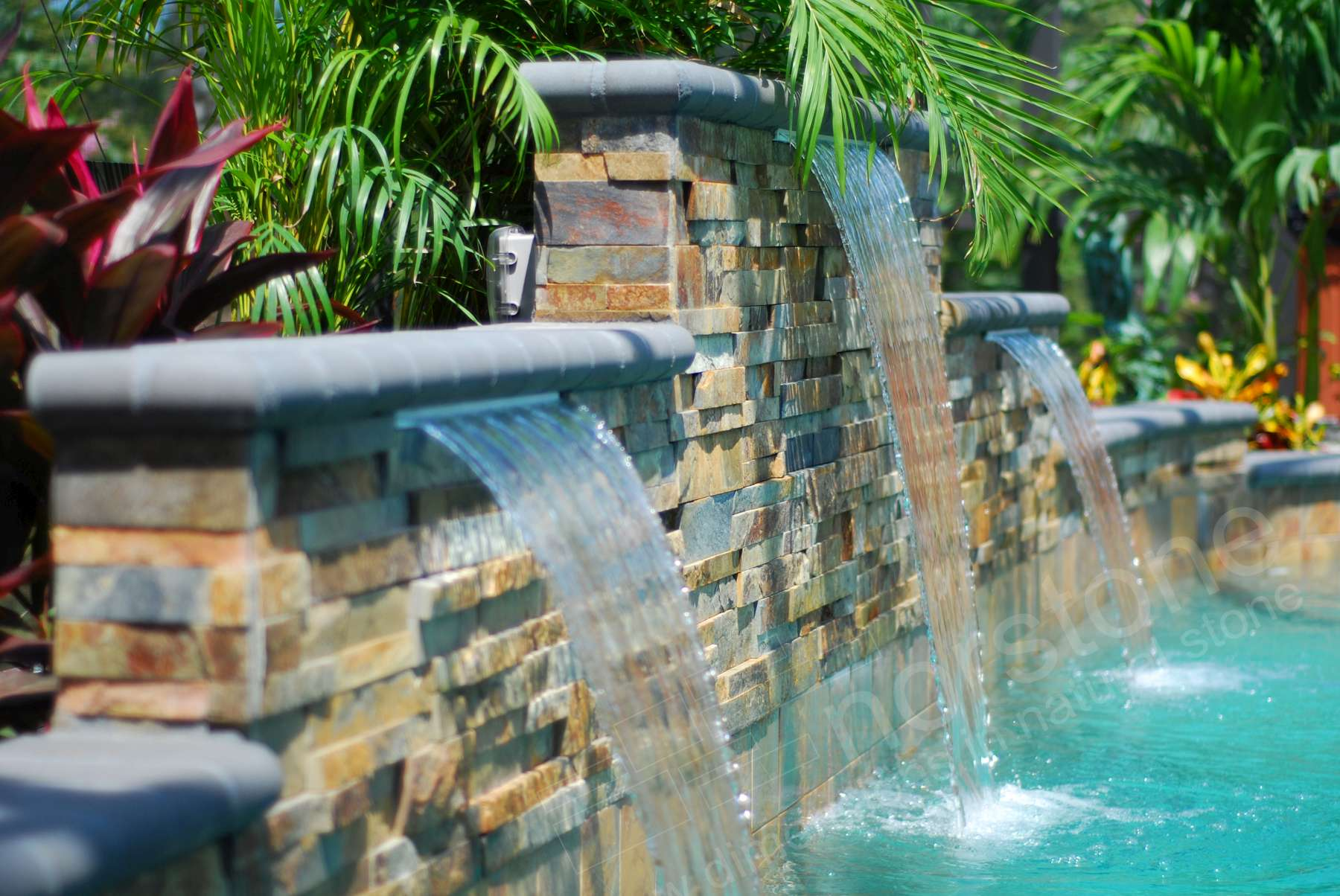 Stacked Stone Pool Water Feature with multiple levels and three waterfalls