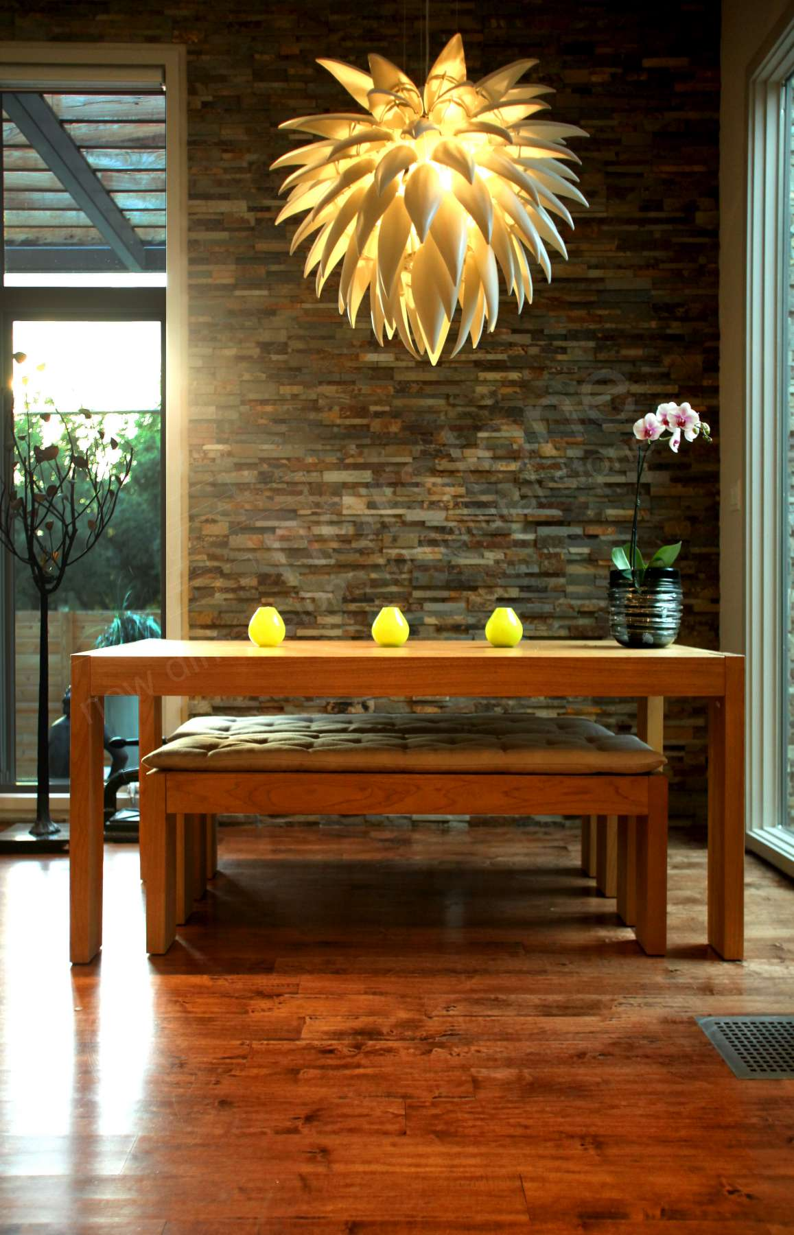 Ochre Stacked Stone Feature Wall with Sunburst Chandelier in Austin, TX