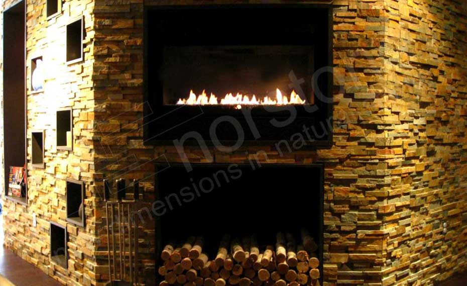 Stacked Stone veneer panels for fireplace used in a Basement on a fireplace and surrounding feature walls with cut logs