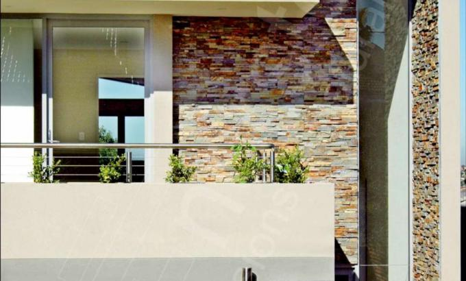 Ochre Rock Panels on a Stacked Stone Facade