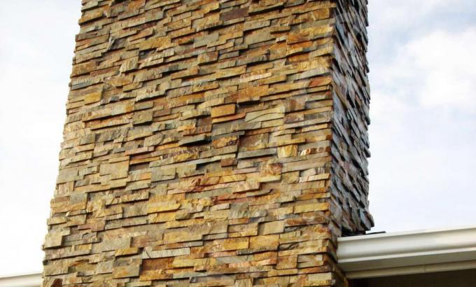 Natural Stacked Stone Veneer Chimney