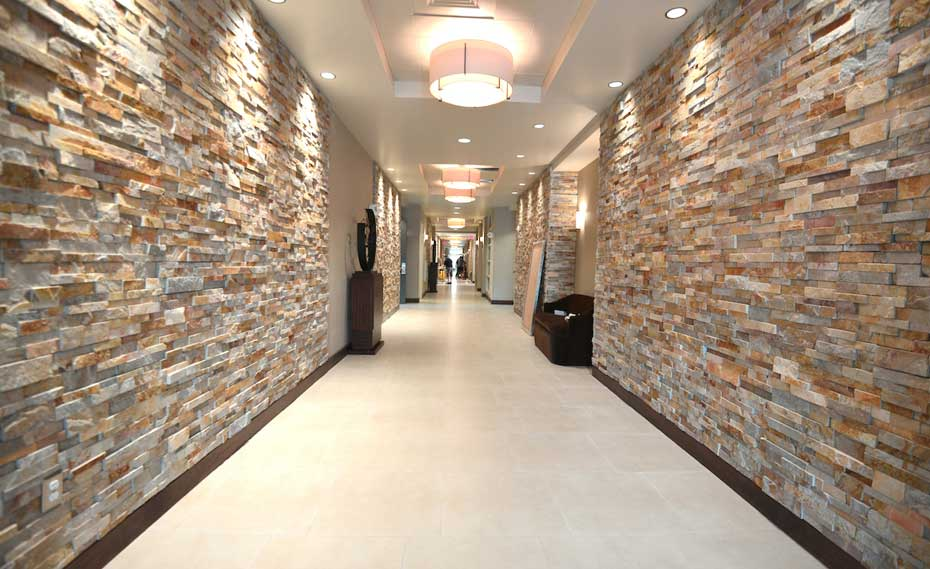 Gold Stacked Stacked Stone Walls in Hallway of Hotel