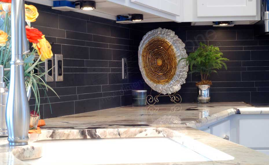 Norstone Ebony Basalt Stone Veneer Backsplash in a kitchen with under cabinet lighting in Chicago