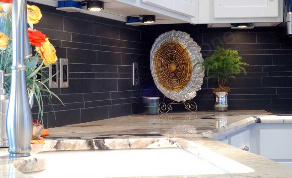 Norstone Ebony Basalt Stone Veneer Backsplash in a kitchen with under cabinet lighting in Chicago
