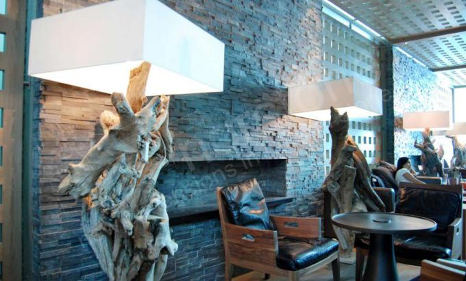 Charcoal Rock Panels for Interior Stacked Stone Fireplace in Commercial Lobby airport in Dubai