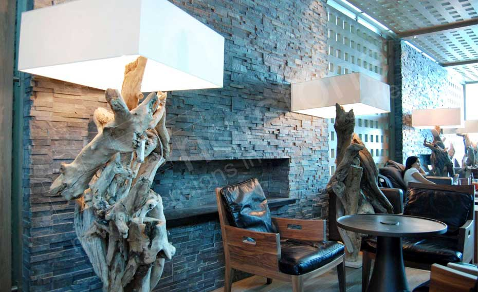 Norstone Charcoal Rock Panels used for as a Natural Stacked Stone Veneer Wall and Fireplace in Airport Lounge in Dubai