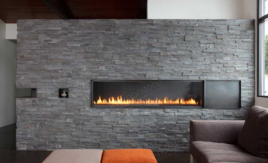 A Stacked Stone Fireplace in a modern living room environment with a flame