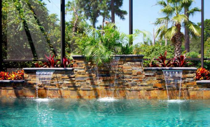Thin Stone Veneer Panels Used for Rising Water Feature Wall on Pools