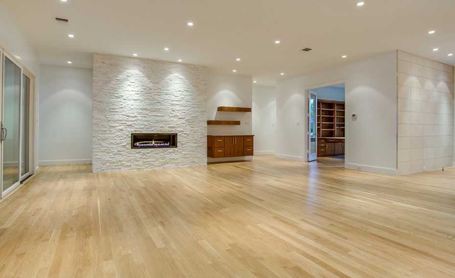 White Quartz Stone Fireplace in living room with wood floors in Dallas Texas