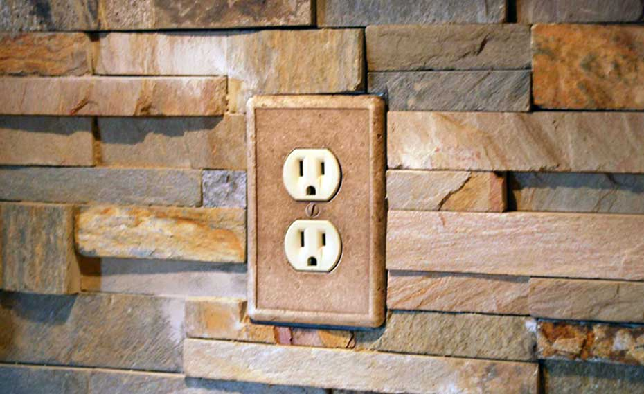 Stacked Natural Stone Veneer Rock Panels with an Outlet