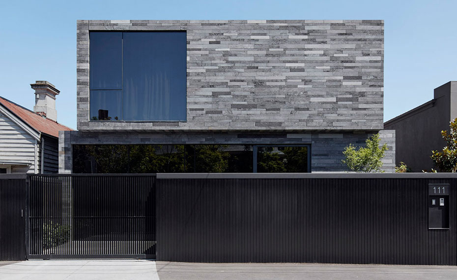 Lavastone Strip Veneer Planks Used on a Contemproary Residential Facade with Large Window