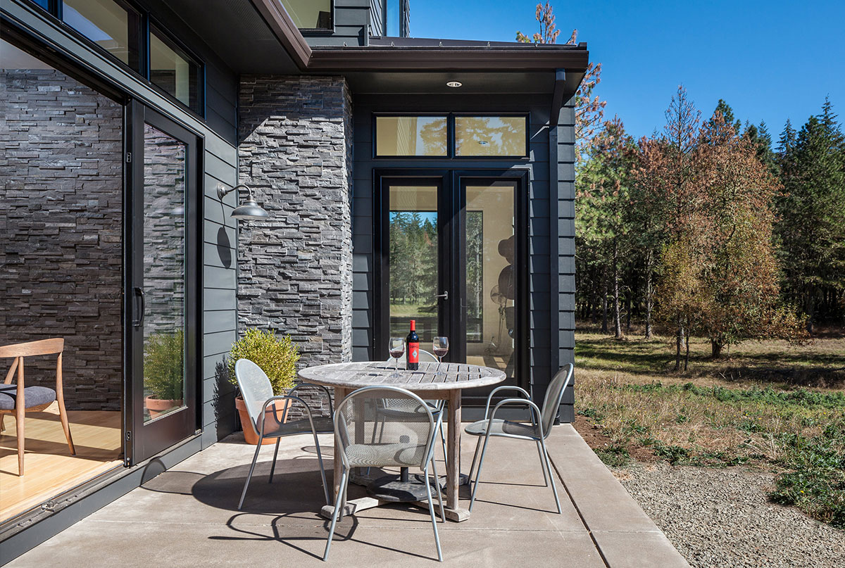 Norstone's Charcoal Panels used on Residential Exterior Wall near patio