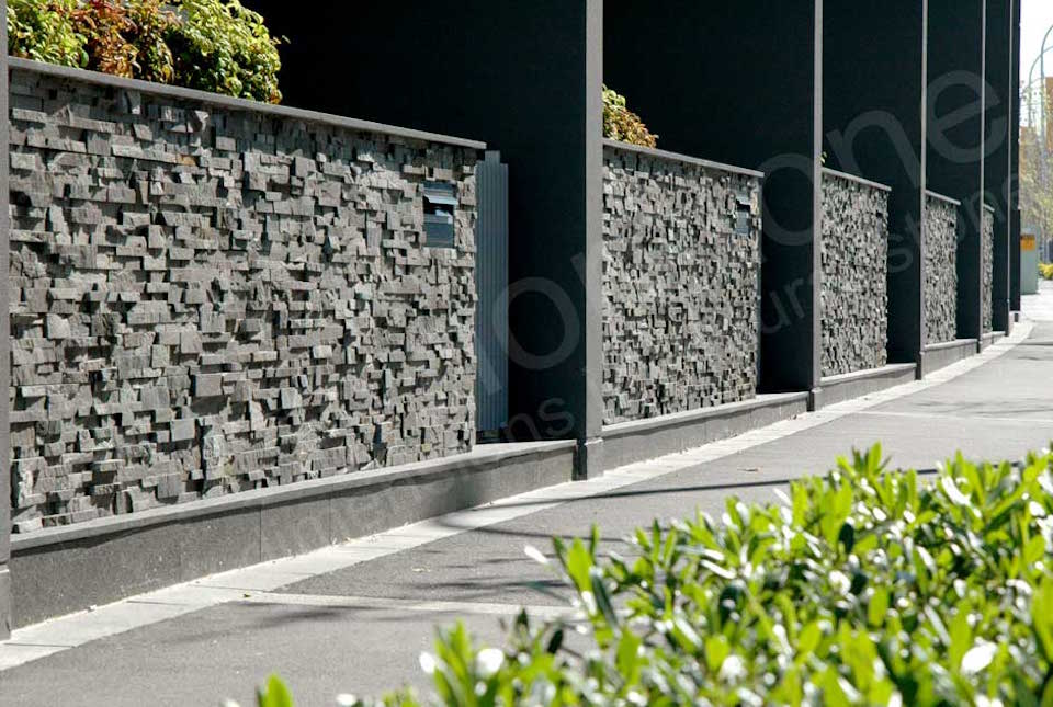 Charcoal Stacked Stone Panels used on Commercial Retaining Wall