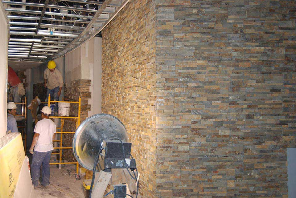Commercial Installation Crew installing Norstone Stacked Stone Panel System in a corridor in Pompano Beach Florida Casino
