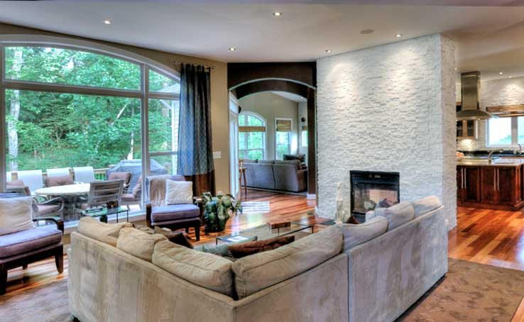 Norstone Living Room with view of Kitchen with White Stacked Stone Backsplash