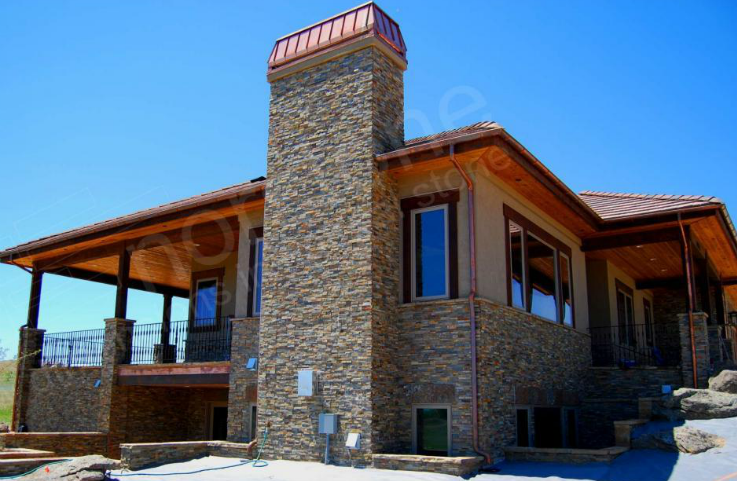 Ochre Stacked Stone Exterior Wall Installation Colorado