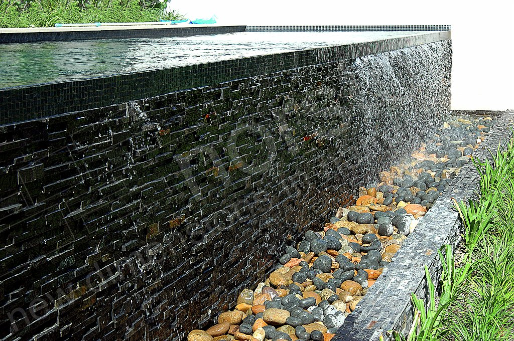 Charcoal Stacked Stone Infinity Edge Ledge Pool