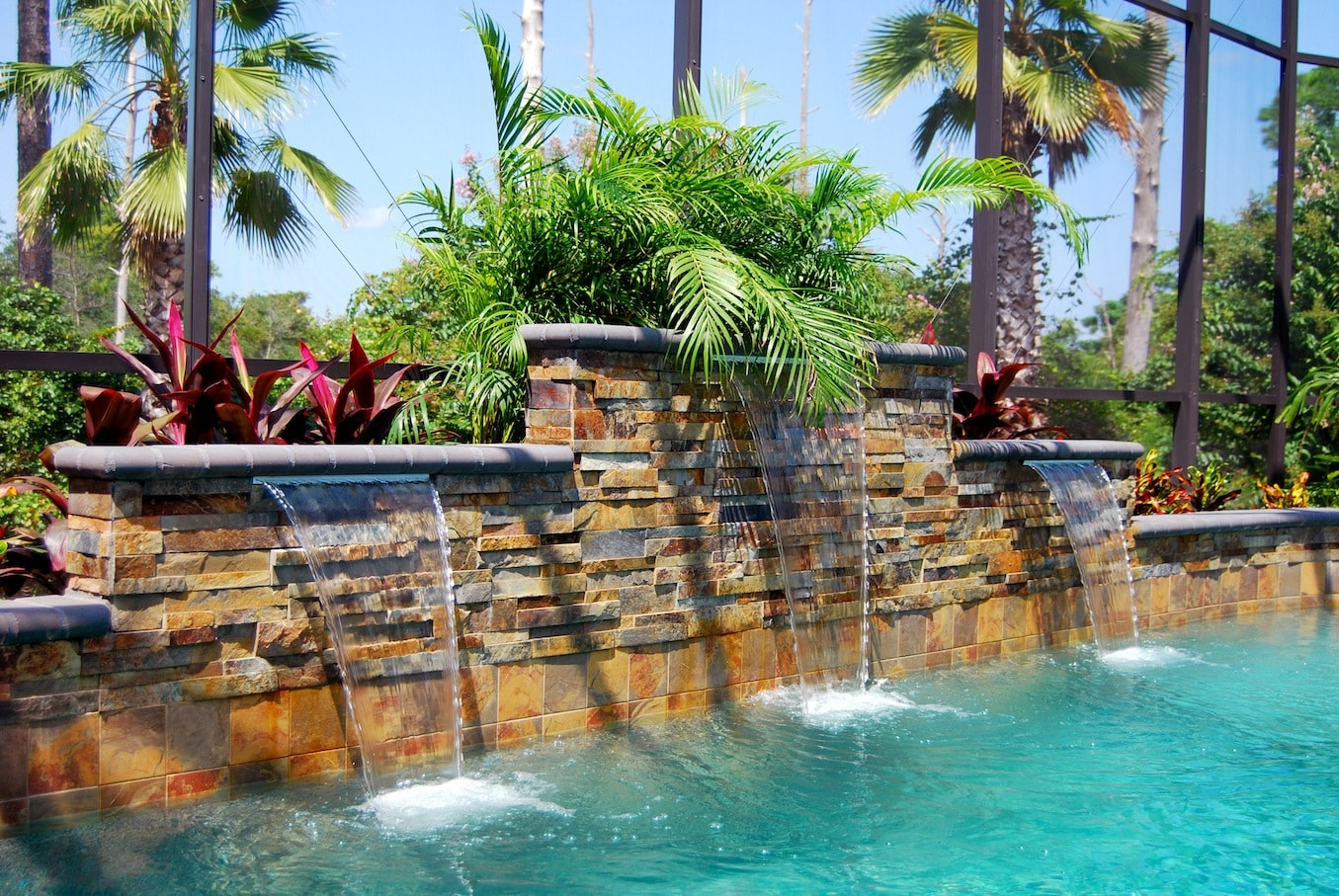 Ochre Stacked Stone Raised Beam Water Feature in Pool