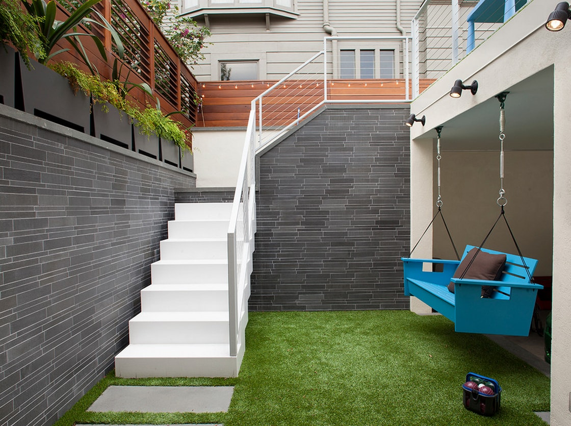 City Backyard in San Francisco featuring artificial turf and a grey interlocking tile feature wall
