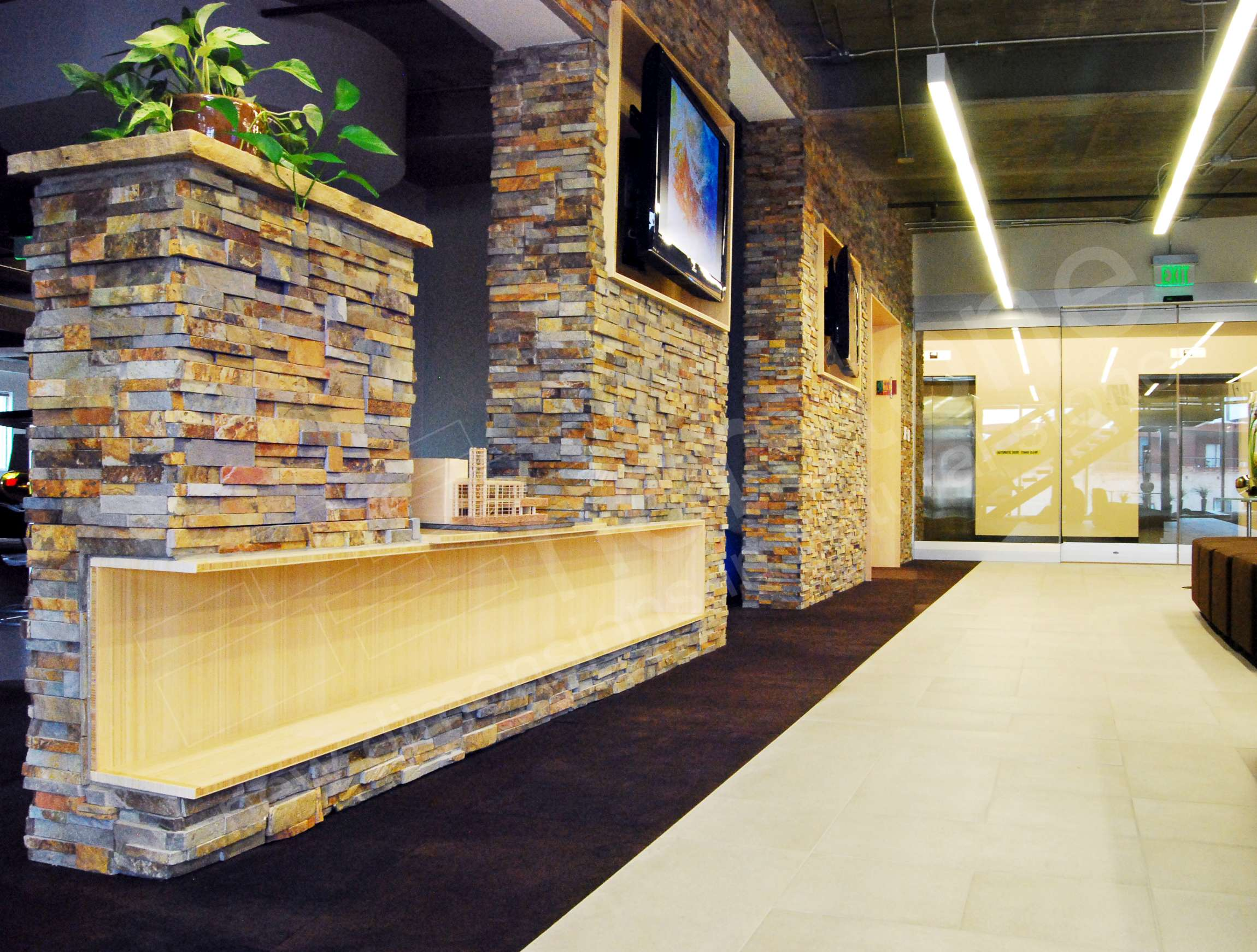 Ochre Stacked Stone Dividing Wall in Architecture Firm office Denver