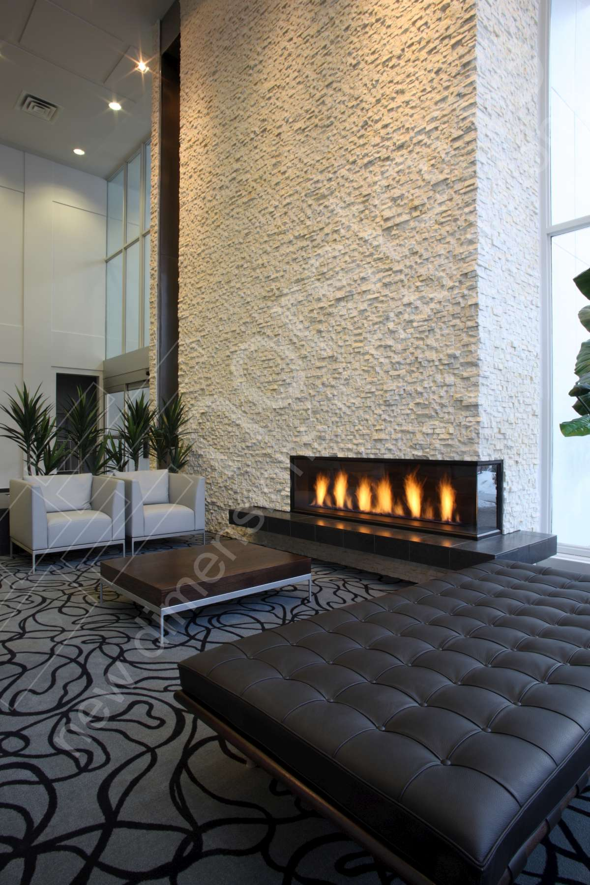 White stacked stone modern fireplace in hotel lobby alberta canada