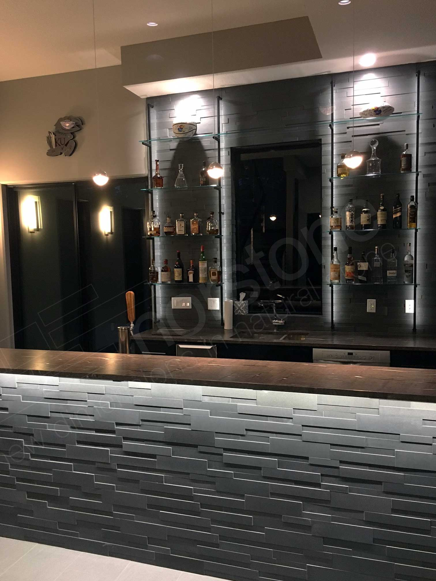 Modern styled bar with grey 3D ledge stone used on facing and backsplash