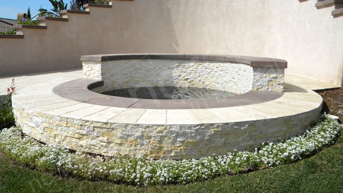 Stacked Stone Concave and Convex Curved Wall Outdoor Hot Tub