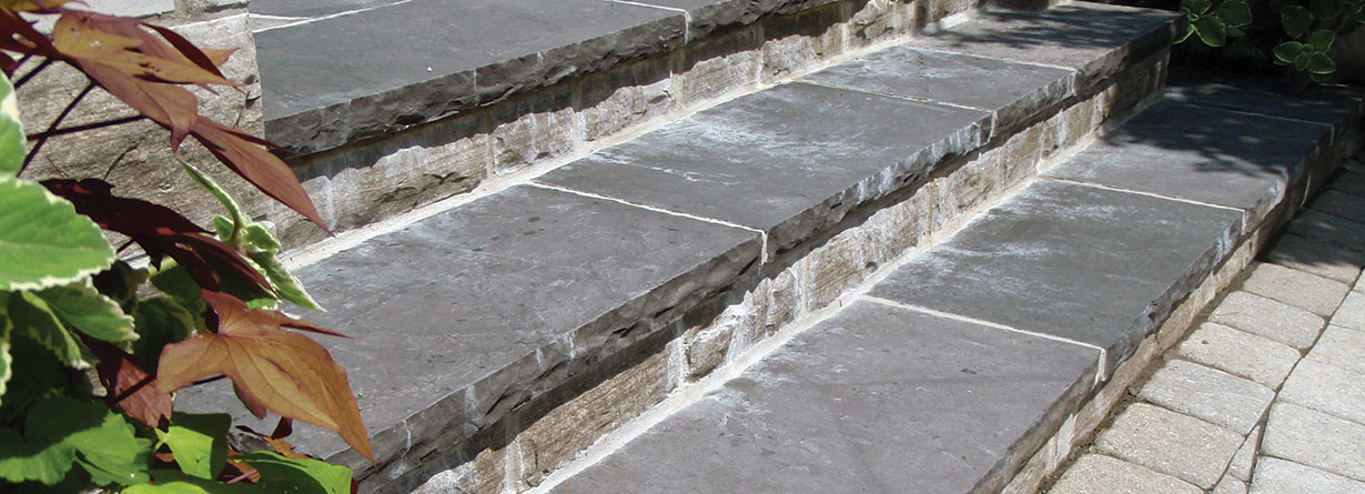 Effloresence showing on the face of natural stone used as the risers on outdoor steps