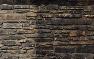 Stone veneer that has been sealed on one side and left unsealed on the other side to show the difference in sheen