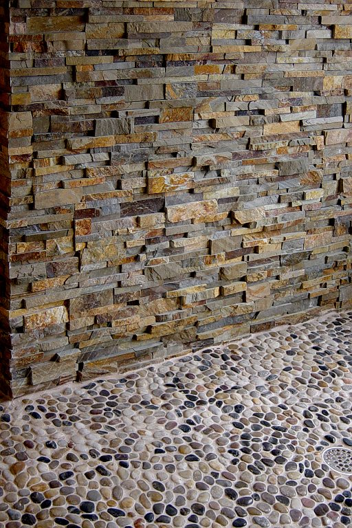 Stacked Stone Shower Feature Wall that has been sealed to protect and enhance the stone